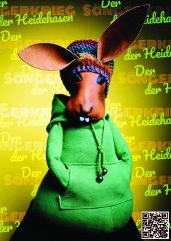 Lodengrün aus der Figurentheater Produktion 'Der Sängerkrieg der Heidehasen' von Figurenspielerin Julia Raab, hier als Sticker zum Einkleben in 'Das große Heft vom Sängerkrieg der Heidehasen', das theaterpädagogische Begleitheft zur Inszenierung.
